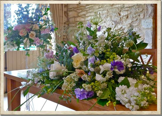 Cotswolds country wedding registrar table flowers
